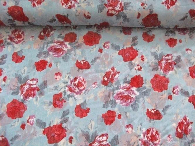 Chiffon L12207-1 in pastellblau mit Rosendruck rot-violett
